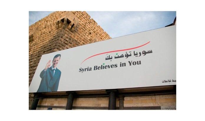 Plakat med Bashir Assad i Damaskus. (Foto: BillBl, flickr.com)