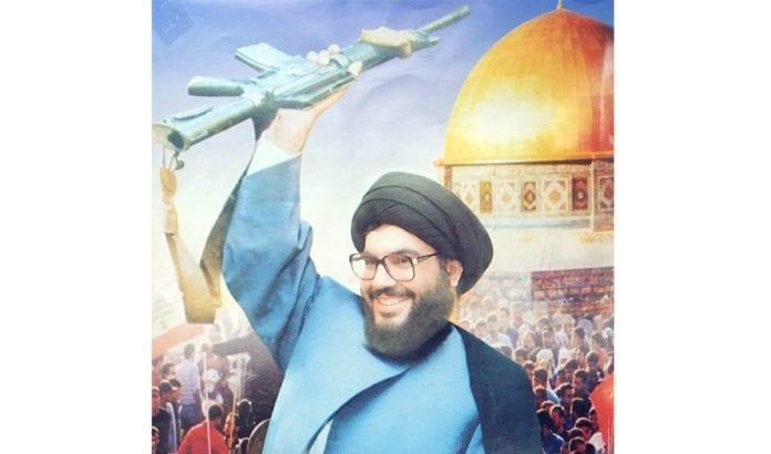 Hassan Nasrallah på en plakat i Damaskus. (Foto: delayed gratification, flickr.com)