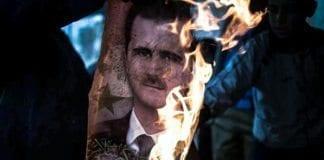 Den hardt pressede syriske presidenten Bashar Assad (på bildet i flammer) har fått militær bistand fra Iran. (Foto: Freedom House)