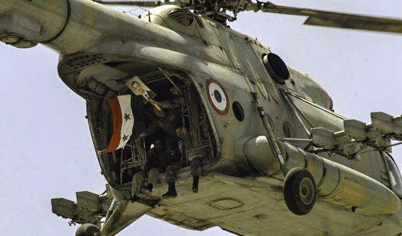 Soldater i et helikopter markerer støtte til president Bashar Assad. (Foto: FreedomHouse, flickr.com)