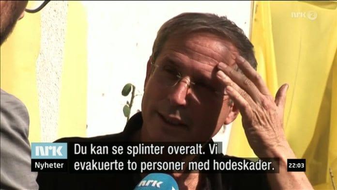 En kibbutzleder forteller om skadene etter et Katyusha-angrep fra Gaza-stripen til NRKs Midtøsten-korrespondent Sigurd Falkenberg Mikkelsen. (Skjermdump fra Dagsrevyen 21 mandag 12. november 2012)