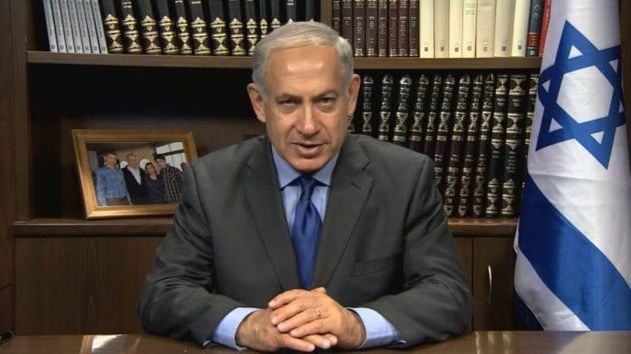 Statsminister Benjamin Netanyahu holder sin nyttårstale til den jødiske verden (Foto: Skjermdump fra IsraeliPM, YouTube.com)