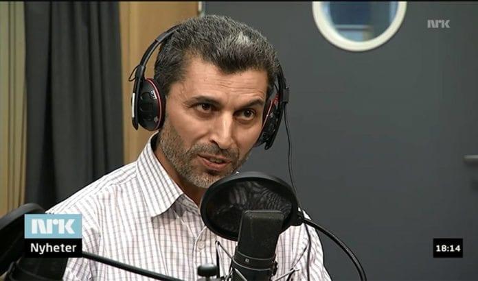 Informasjonsarbeider og muslimsk menighetsforstander Basim Ghozlan fremmet konspirasjonsteoretiske påstander på både VG TV og NRK fredag. (Foto: Skjermdump fra NRK)