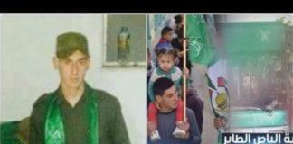 Selvmordsterroristen Abed al-Hamid Abu Srour kledd i uniform og med Hamas-flagg (Foto: Skjermdump fra Twitter)