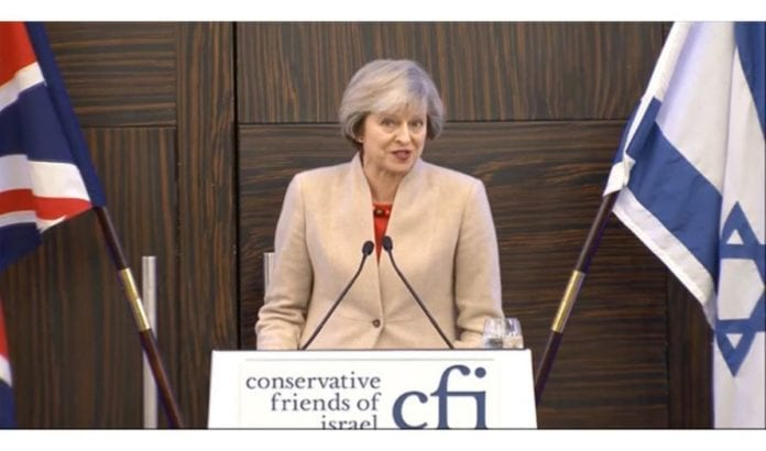 Storbritannias statsminister, Theresa May taler til CFI mandag. 12 desember. (Skjermbilde fra Youtube)