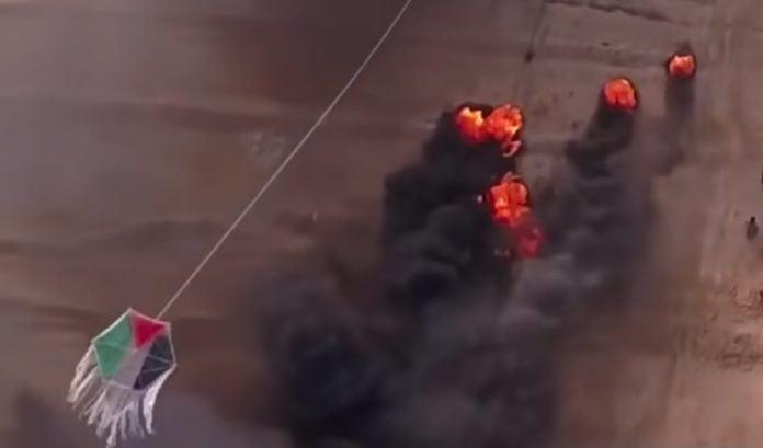 Terrordrage fra Gaza-stripen på vei for å starte nye branner i Israel. (Skjermdump fra filmen Environmental Impact of War fra HonestReporting)